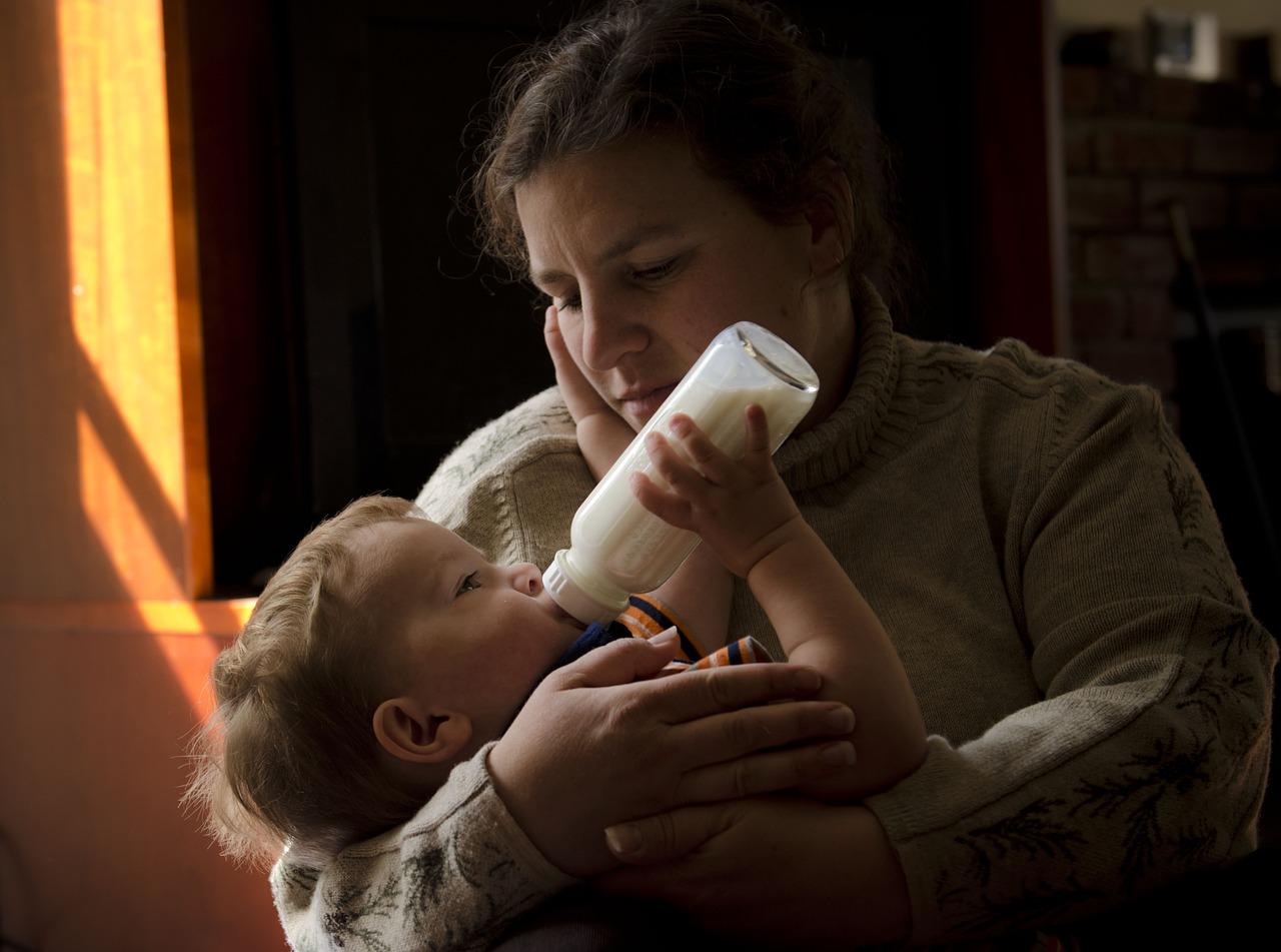 mom feeding baby
